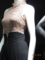 Lace top over form-fitting long black skirt. Very qute.